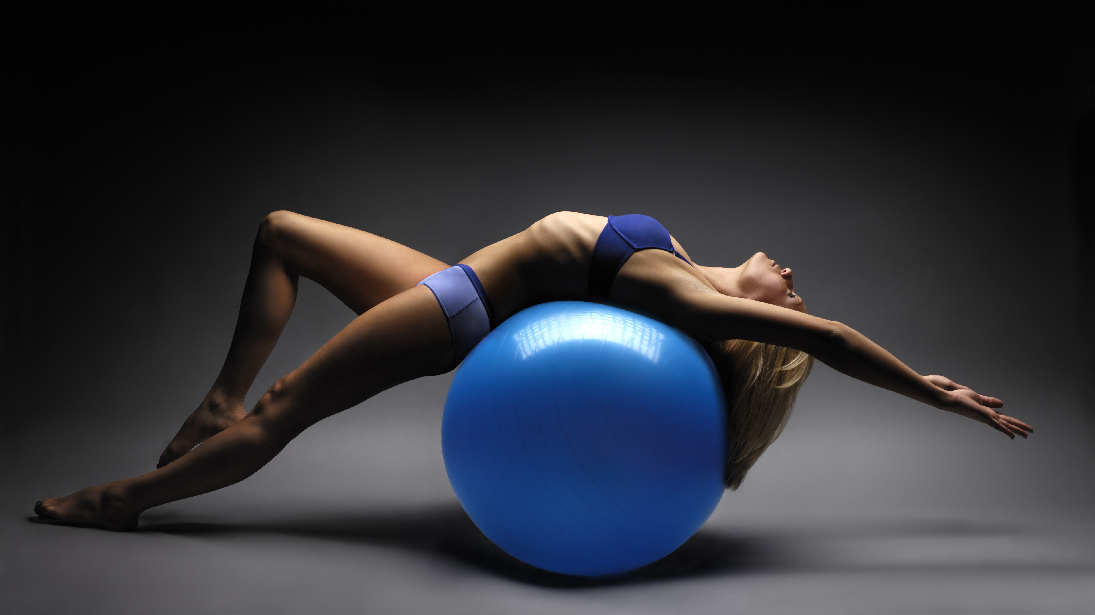 girl-training-on-gym-ball_188