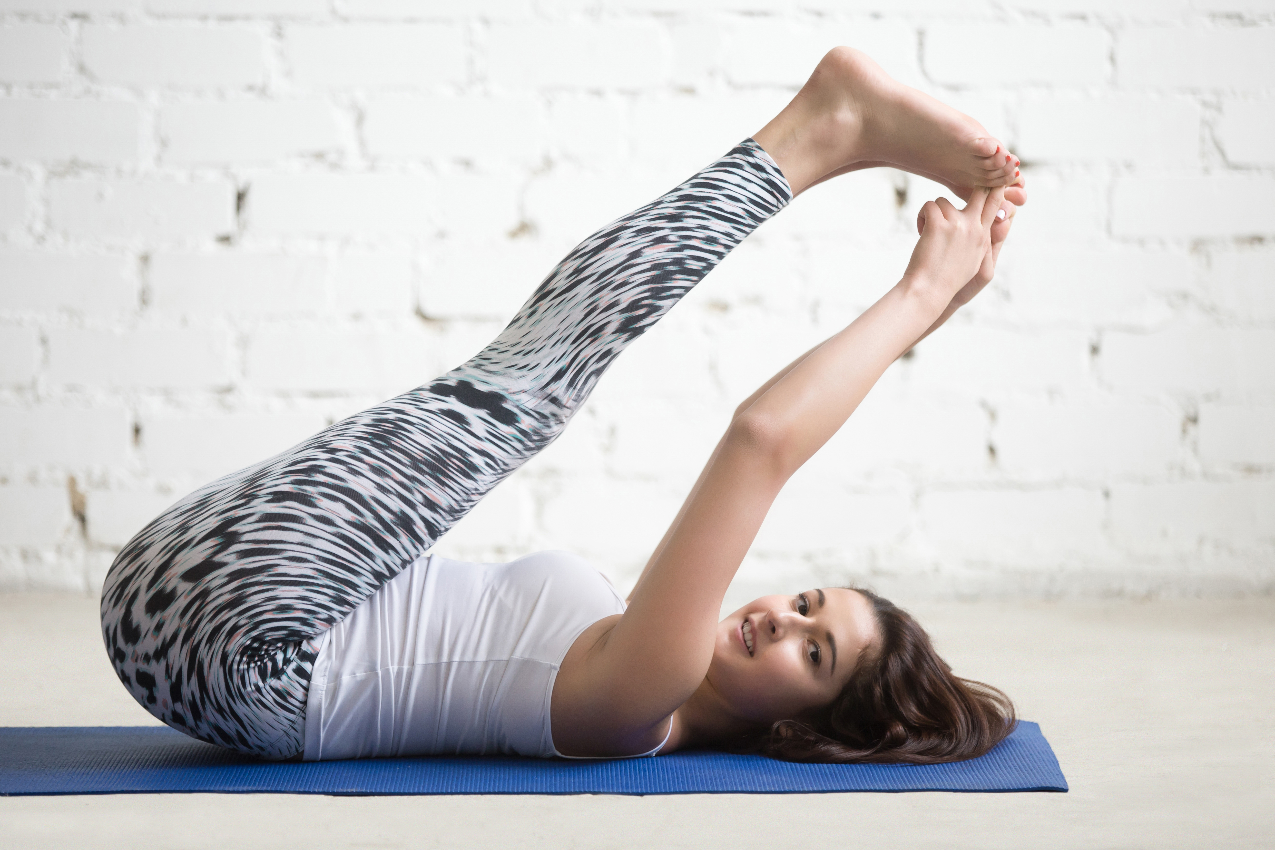 Fitness woman doing exercises on sport mat