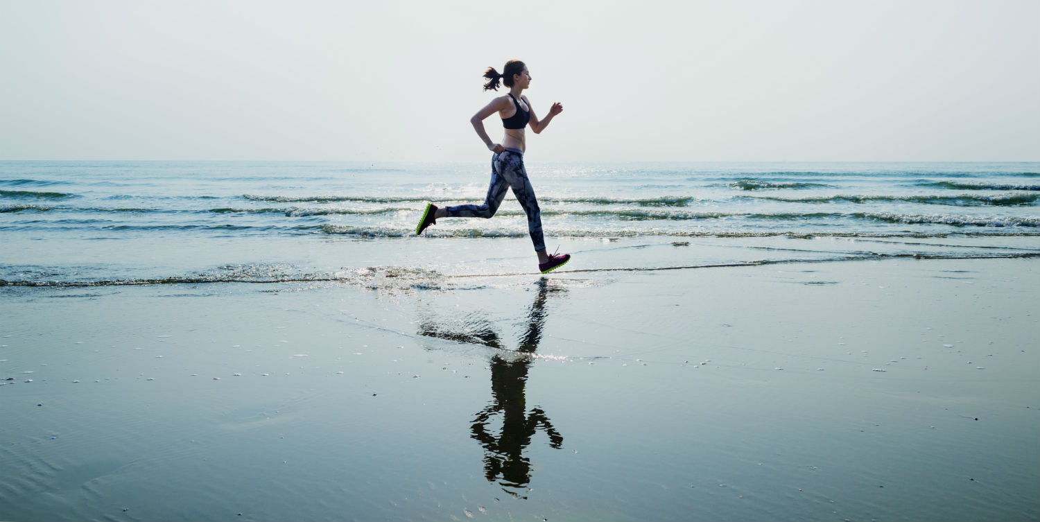 Woman-Running-in-Morning-Beach-The-Luxury-Signature.jpg