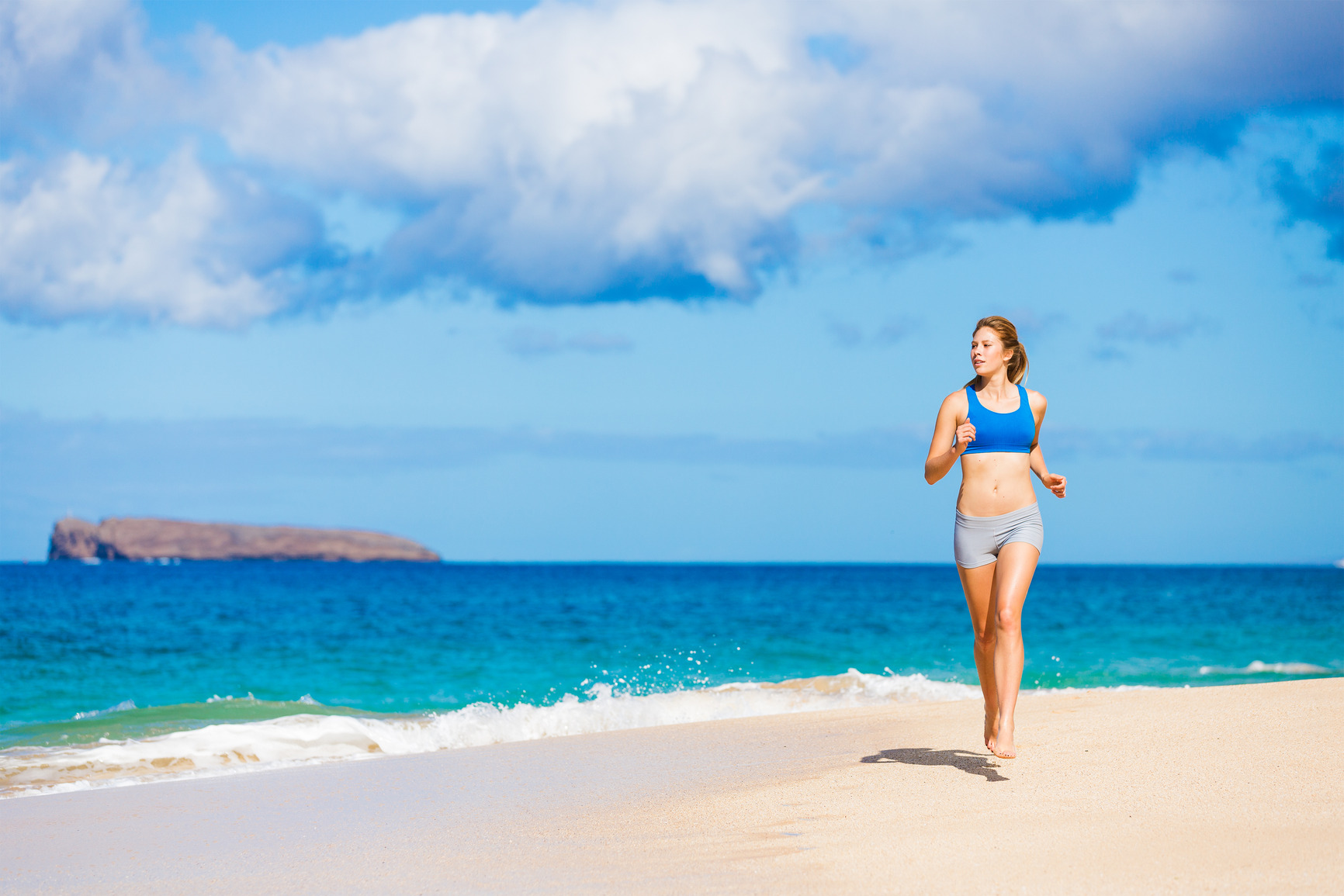 Beautiful Athletic Woman Running on the Beach